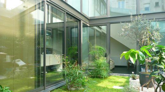 Construction d 39 une maison a patio paris lca laurent for Construction d une verriere